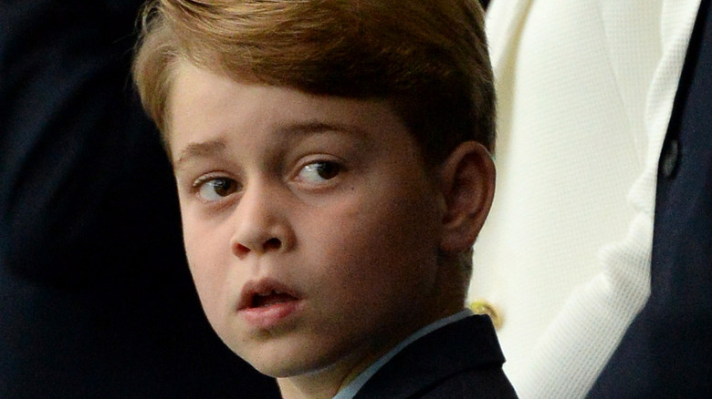 Prince George poses for the camera