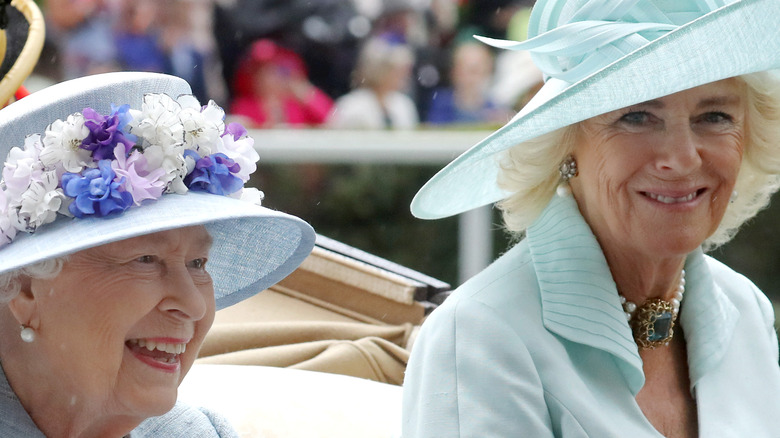 Queen Elizabeth and Camilla Parker Bowles on a carriage