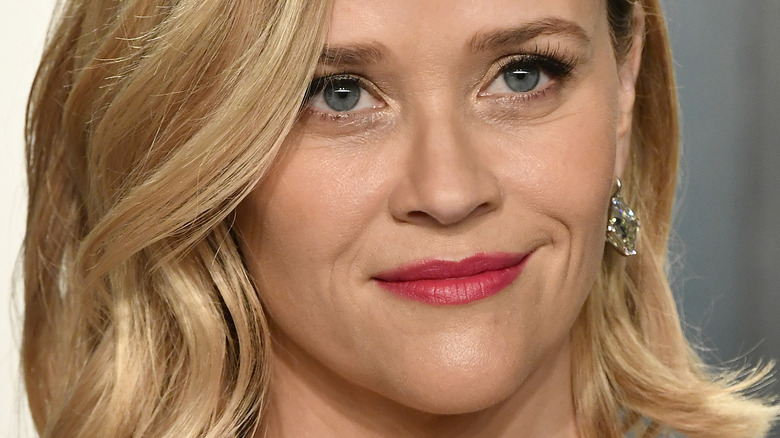 Reese Witherspoon smiling slightly
