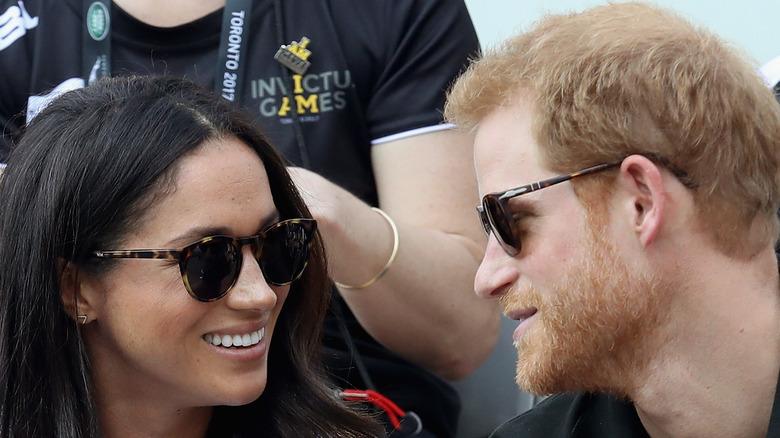 Prince Harry and Meghan Markle wear sunglasses