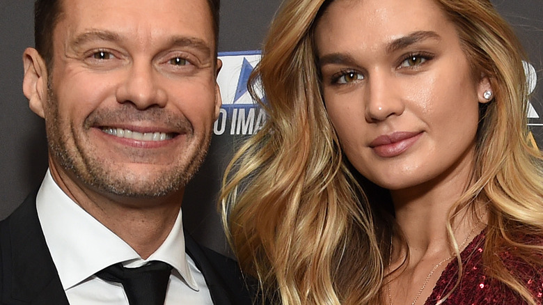Ryan Seacrest smiles with Shayna Taylor