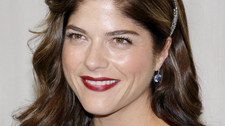 Selma Blair smiles wide at a museum event