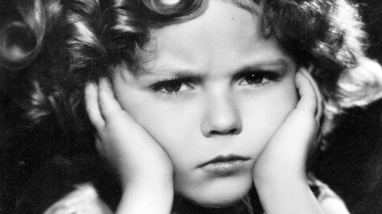 Shirley Temple looking unhappy
