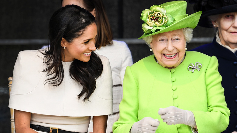 Queen Elizabeth and Meghan Markle laughing