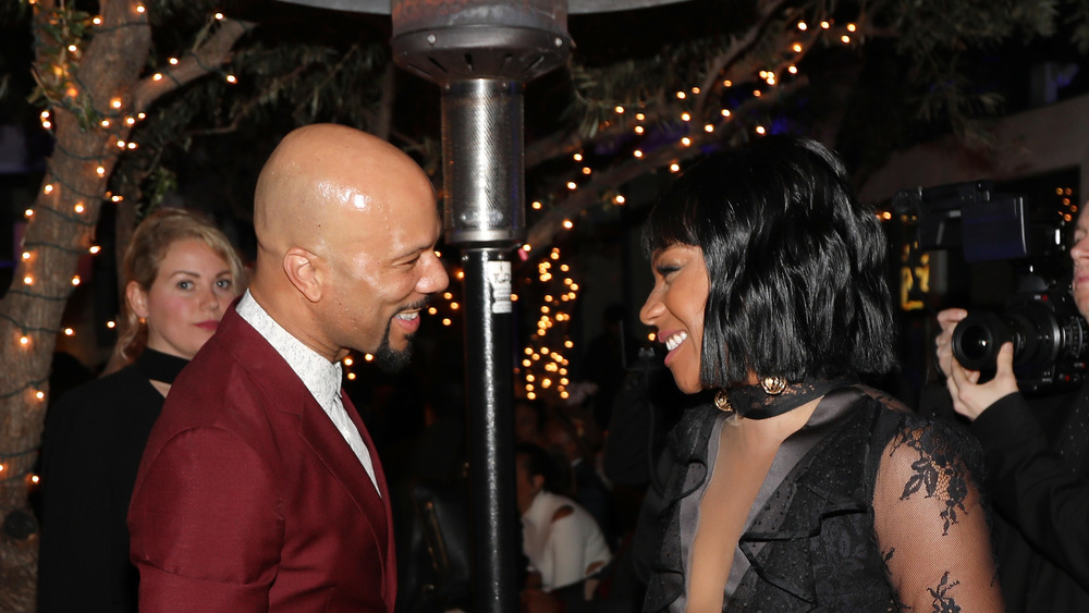 Tiffany Haddish and Common smile at each other