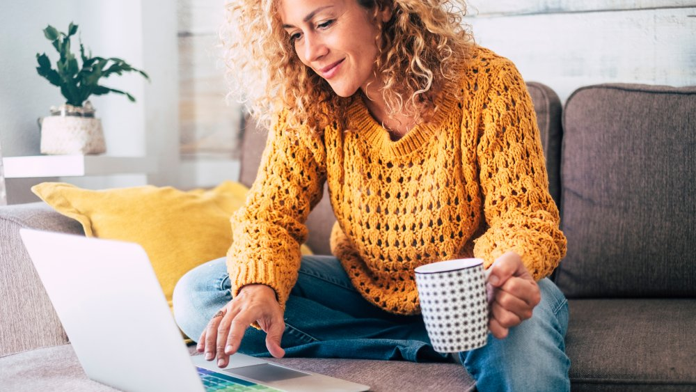 woman on laptop with a mug of coffee