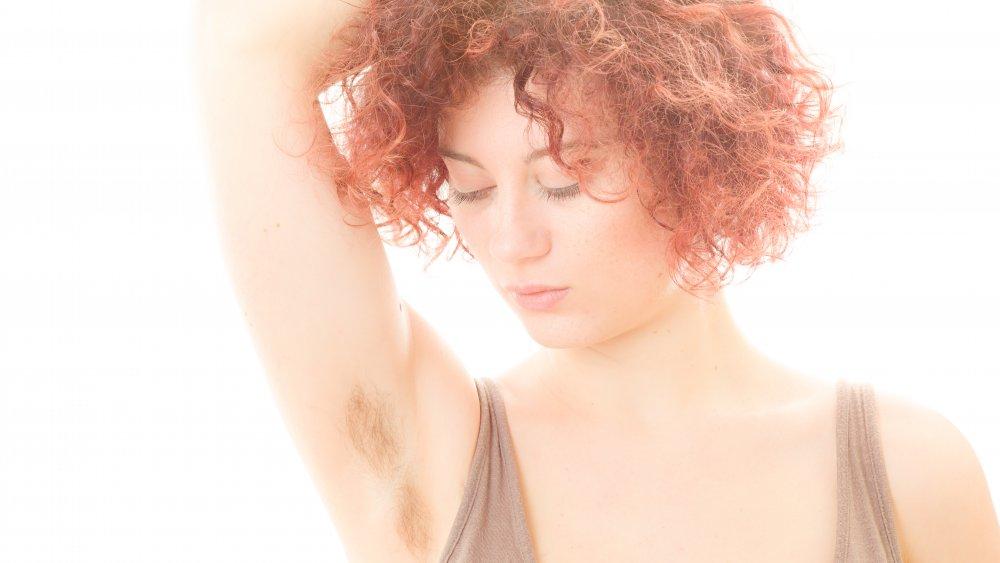 Woman showing armpit hair