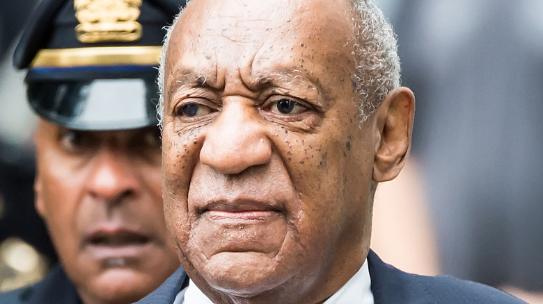 Bill Cosby in front of police