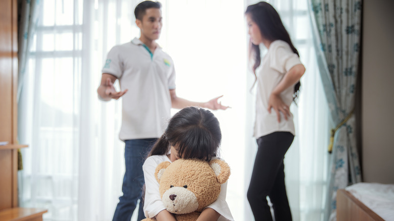 couple disagreeing in front of child