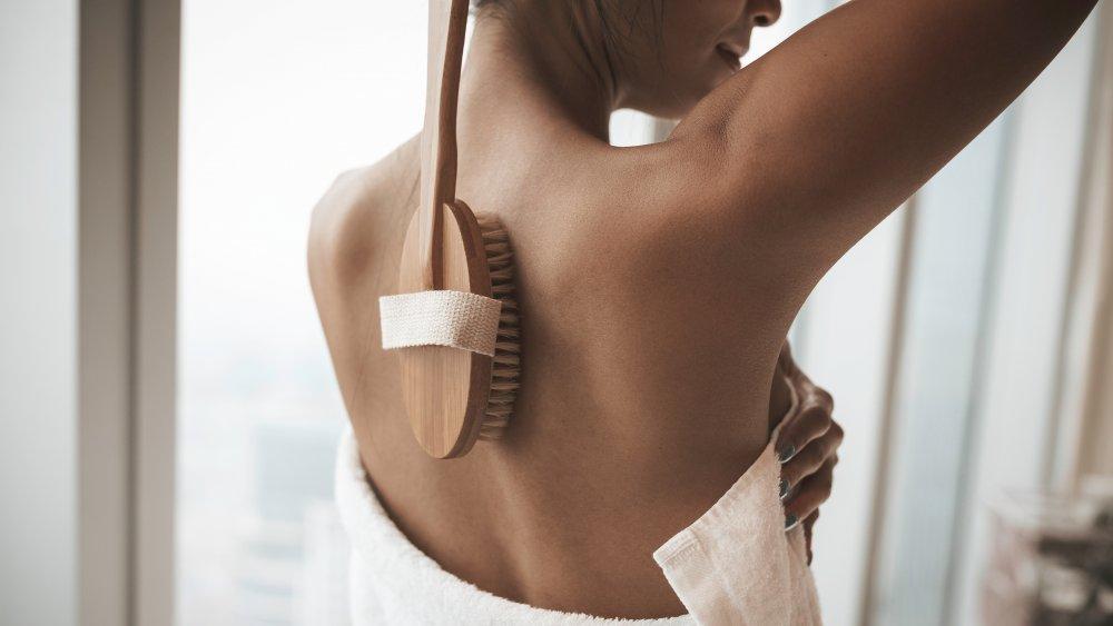 Woman scrubbing her back
