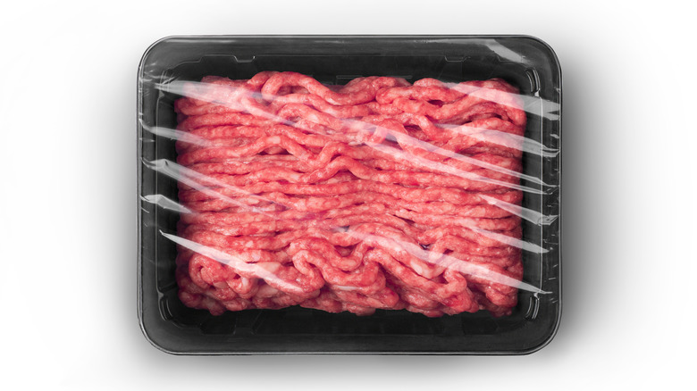 Prepackaged ground beef on an isolated white background
