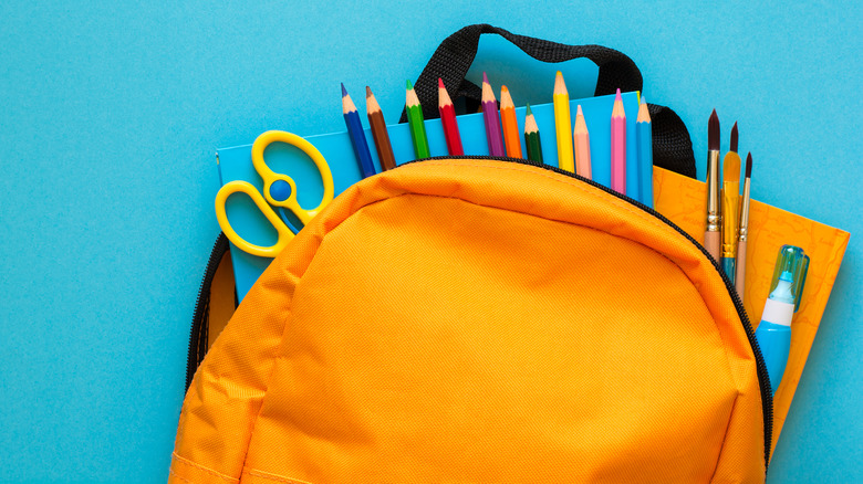 backpack and pencils on table