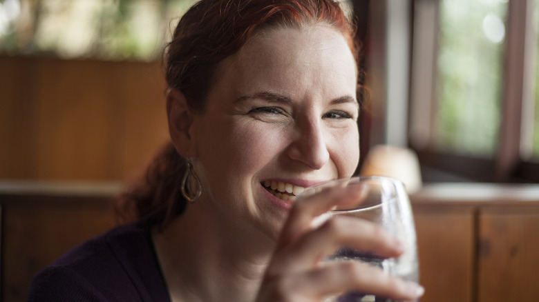 Woman in restaurant sipping water