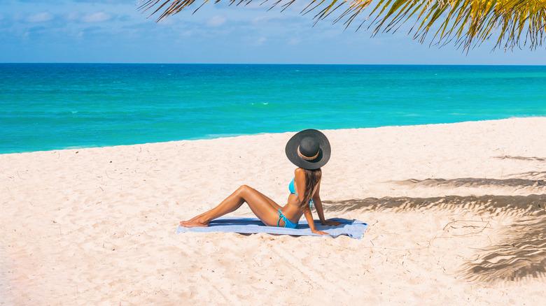 Woman sunbathing on an island