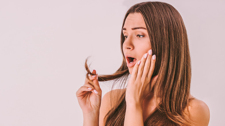 Woman shocked at her broken strands