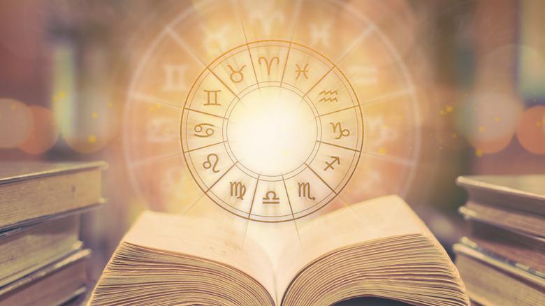 A zodiac sigil hovering over a book