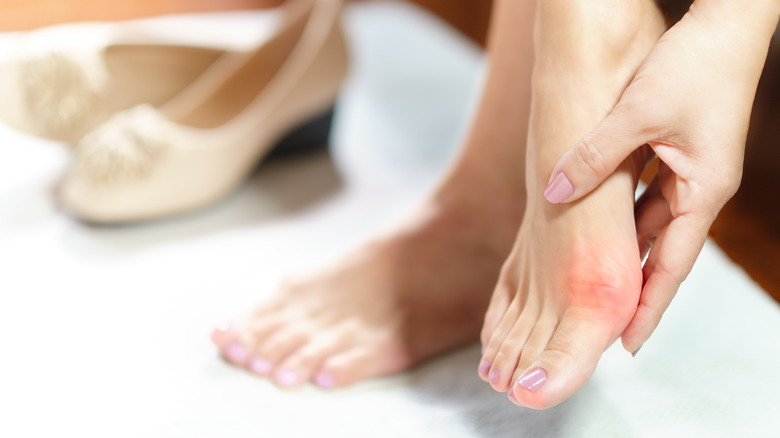 Woman with foot pain due to improper footwear