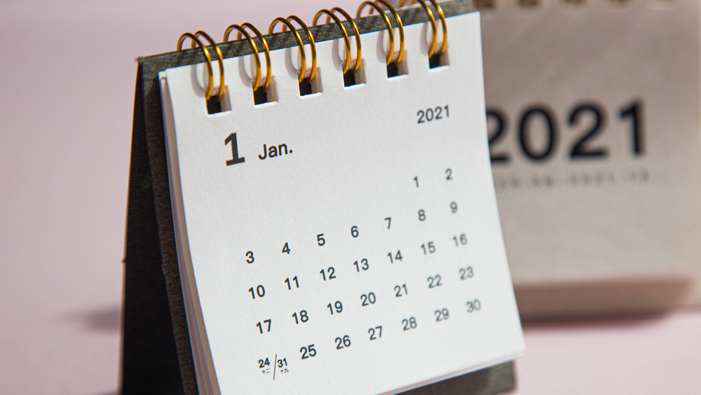 paper calendar with a pink background