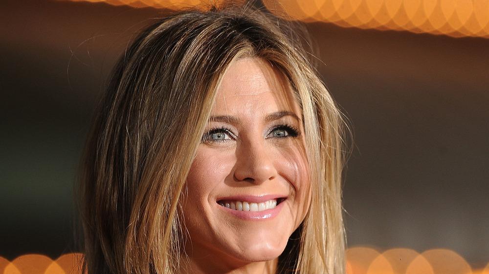 Jennifer Aniston smiles on the red carpet