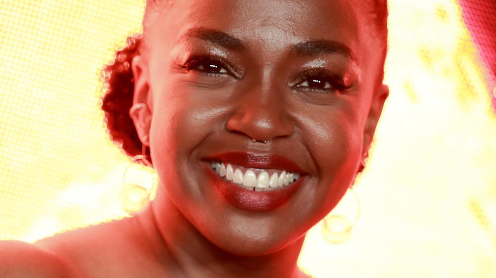 Jerrika Hinton smiling lit background