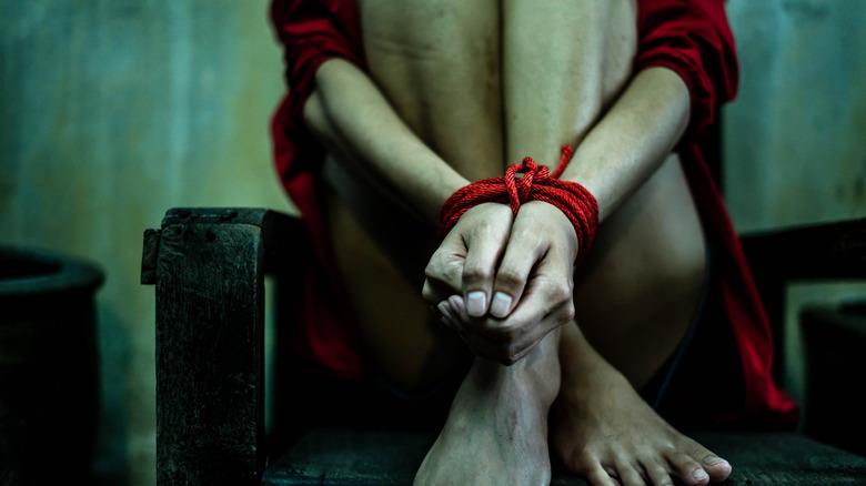 Woman hands tied