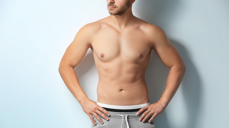 Topless man with exposed nipples