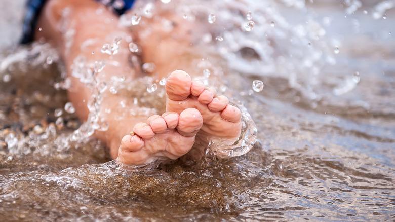 Wrinkled fingers in water