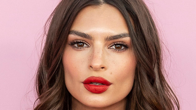 Emily Ratajkowski in a red lip look