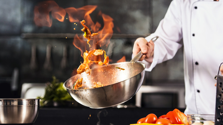 Chef cooking in professional kitchen