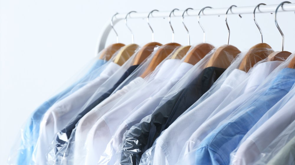 Dry cleaning hanging on a rack