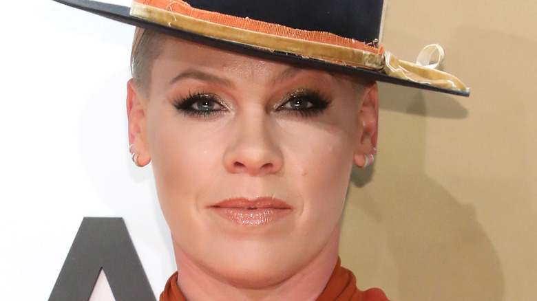Pink posing in a hat