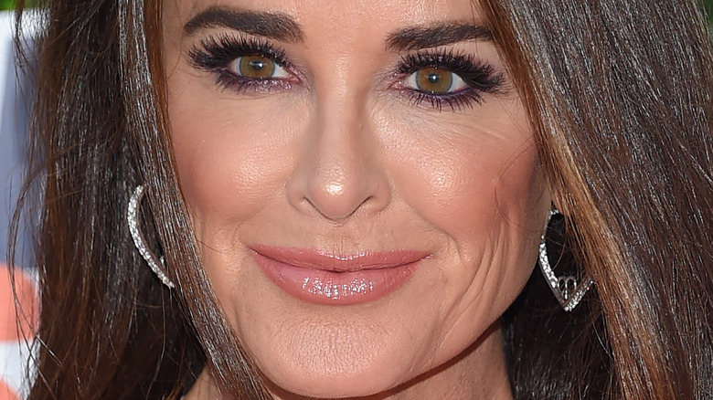 Kyle Richards wears pink dress with her hair down