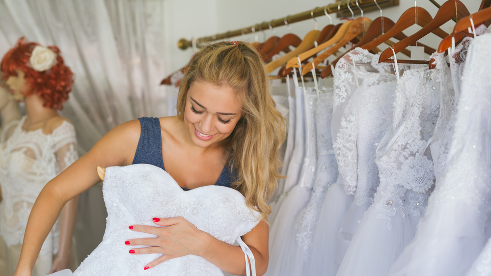 Woman picking wedding dress