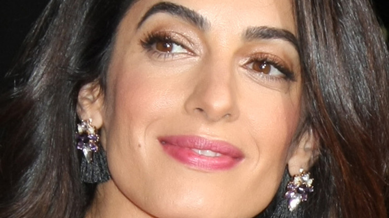 Closeup of Amal Clooney smiling.