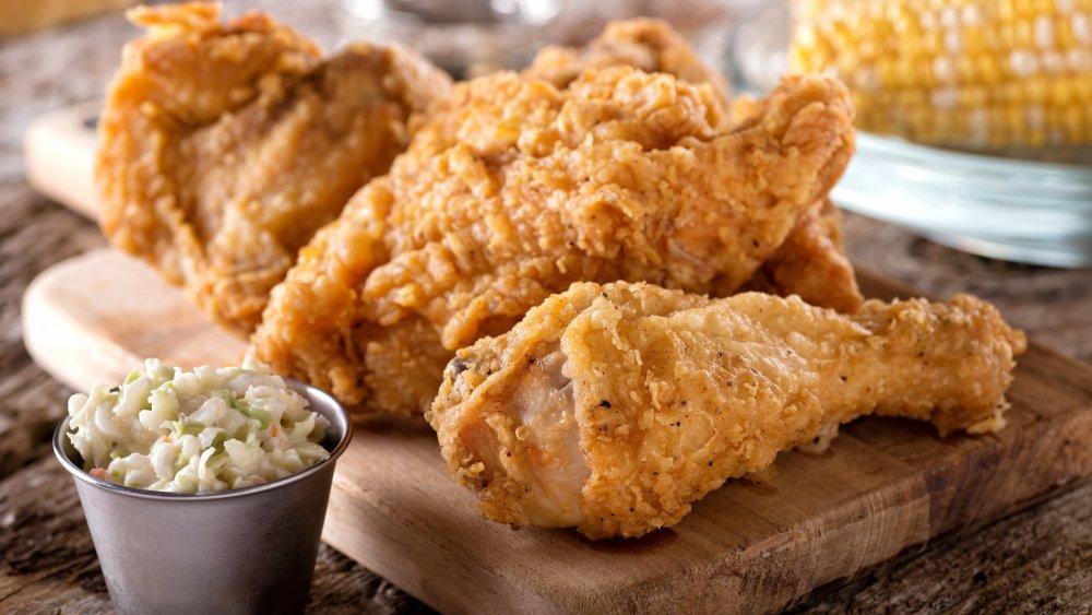 Fried chicken on a wooden platter