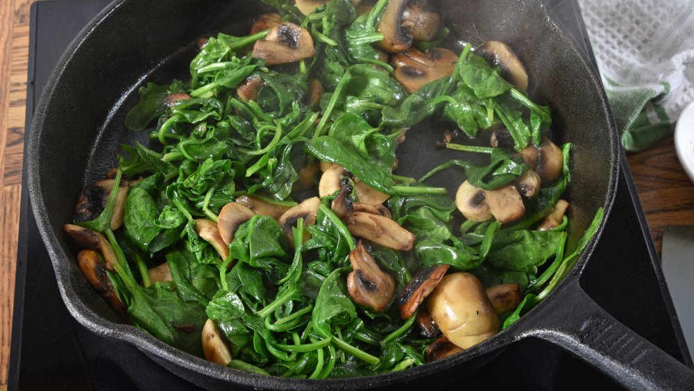 mushrooms and spinach in a skillet