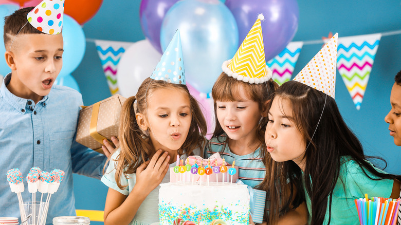 Kids in party hats at birthday party