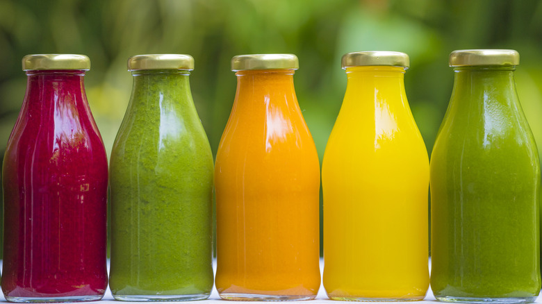 vegetable juices in glass bottles