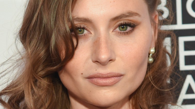 Aly Michalka poses on the red carpet