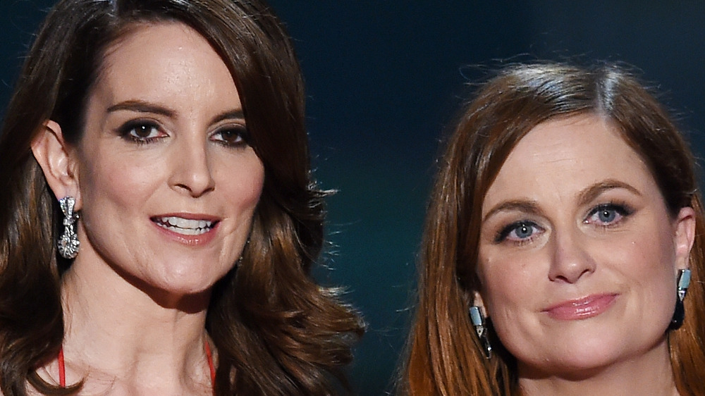 Tina Fey and Amy Poehler present at an awards show