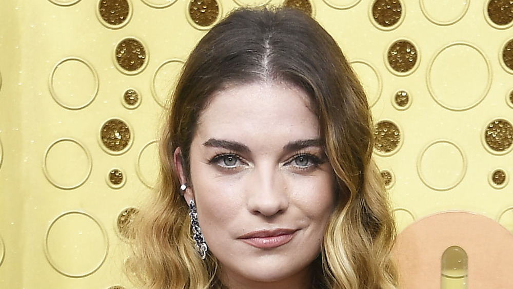 Annie Murphy poses on the red carpet