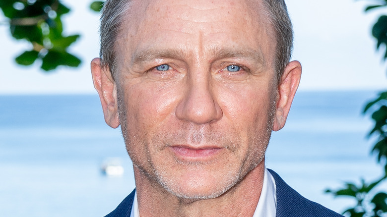 Daniel Craig poses outdoors