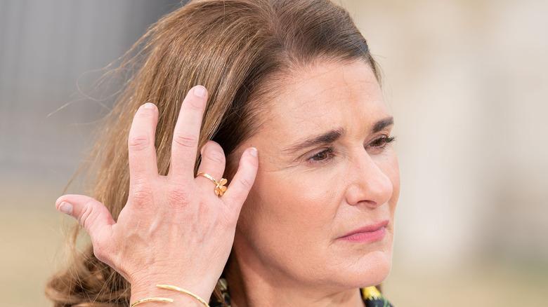 Melinda Gates brushing her hair back