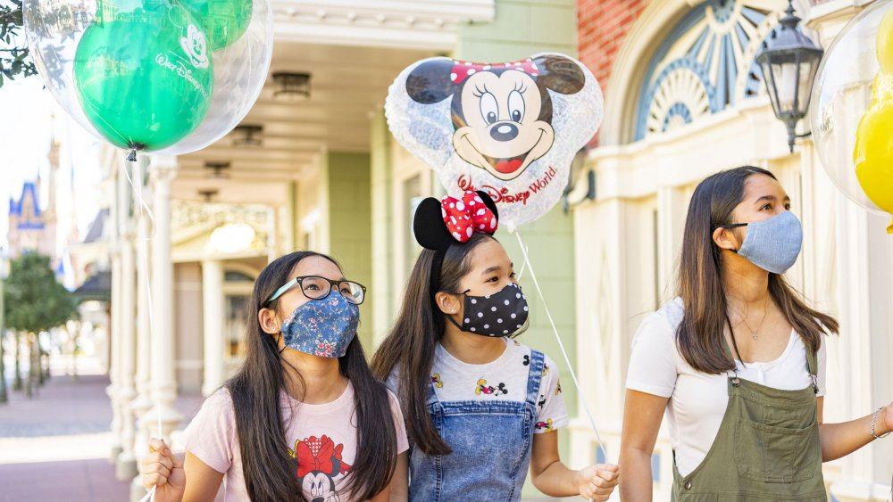 Disney World guests with face masks