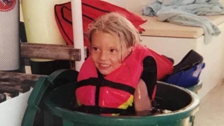 Anya Taylor-Joy as a girl in a bucket