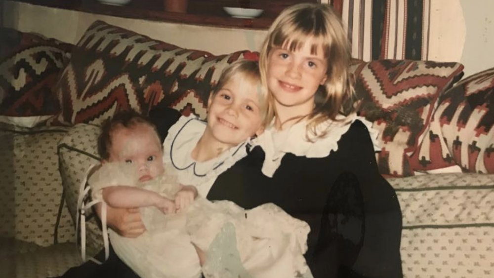 Cara Delevingne as a baby with her sisters