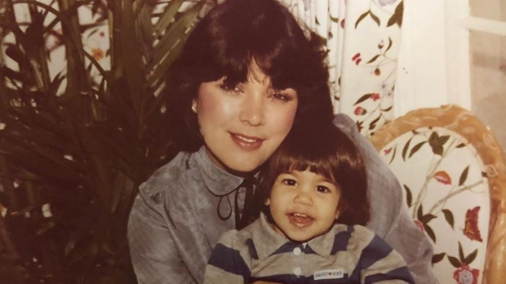 Kourtney Kardashian as a girl with her mother, smiling