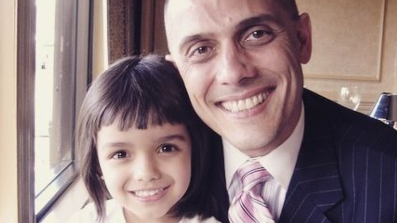 A young Rachel Zegler with her father