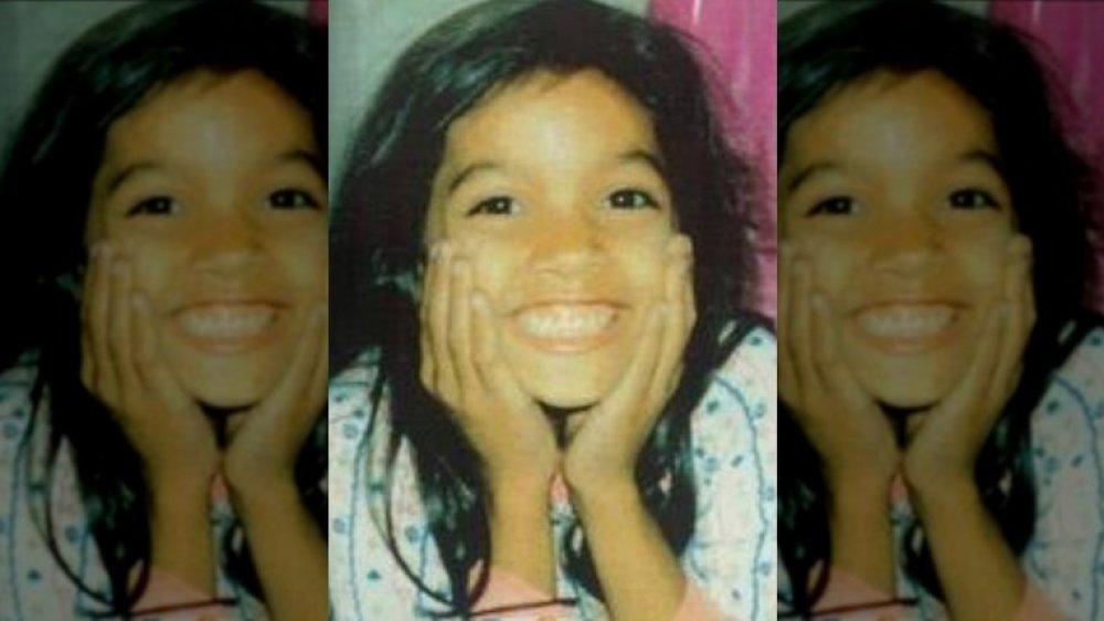 Rosario Dawson as a young girl