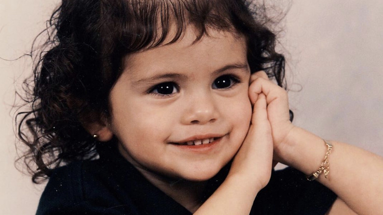 Selena Gomez as a young girl, wearing black